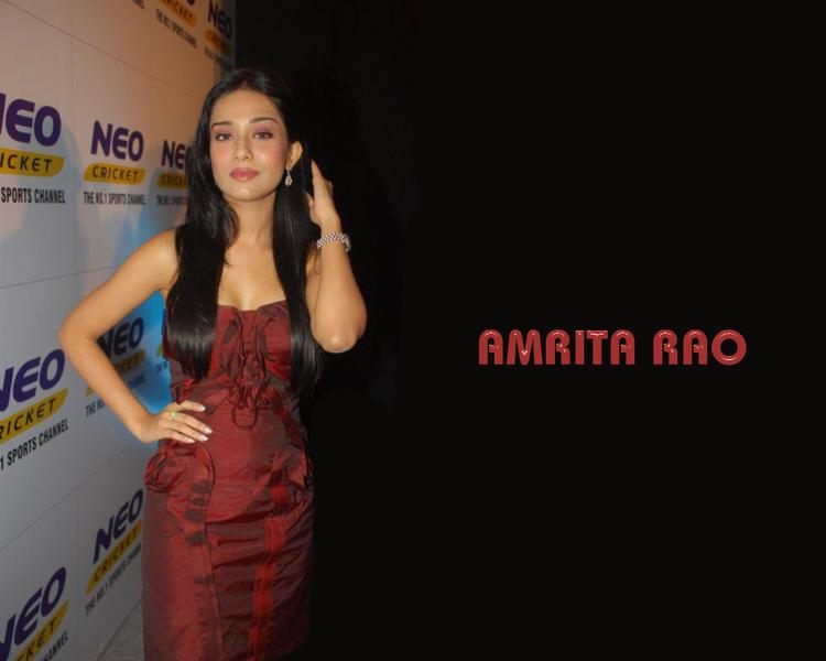 Amrita Rao Gorgeous Wallpaper In Maroon Color Dress