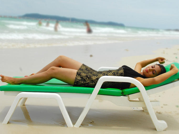 Shraddha Arya Sleeping Pose In Beach Photo Shoot