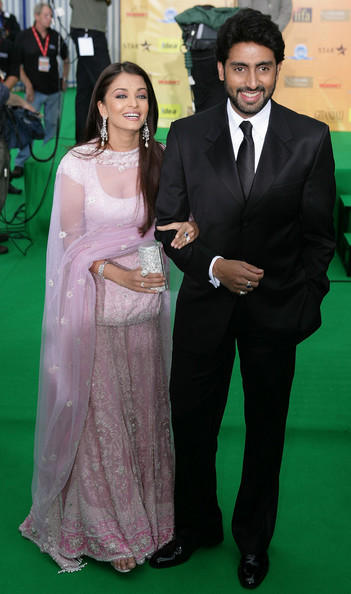 Abhishek Bachchan atn Aish Latest Still On Green Carpet
