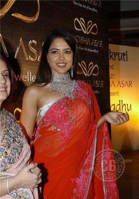 Sameera Reddy Red Saree Hot Pics