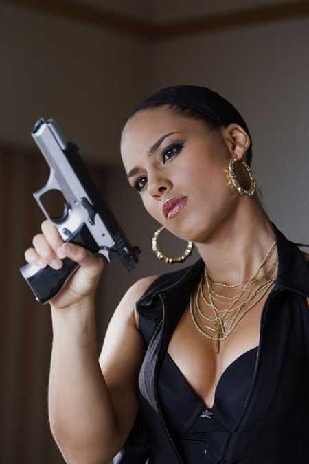 Alicia Keys Serious Look With A Gun