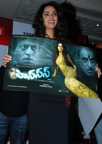 Mallika Sherawat Smiling Pics At Promoting Her Movie Hisss In Hyderabad