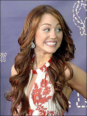 Miley Cyrus Sexy Smile and Curly Hair Style Picture