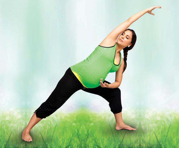An 8 Months Pregnant Lara Dutta Yoga Pose Photo Shoot