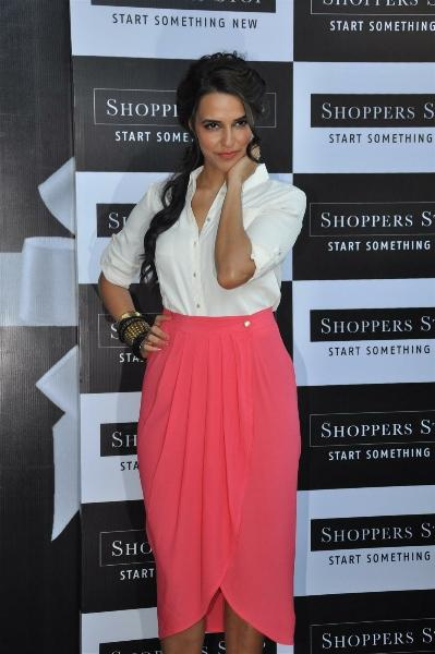 Neha Dhupia Sexy Pose at Shoppers Stop Gift Card Launch