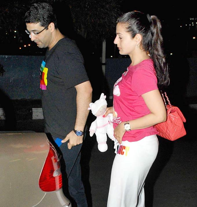 Amisha Patel With A Doll At Airport