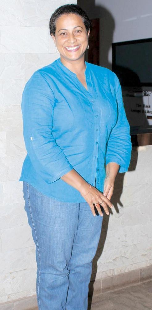 Mona Ambegaonkar Flashes A Smile