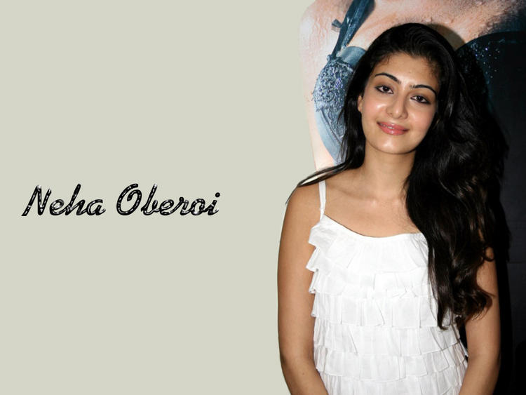 Neha Oberoi Dazzling Face Look With Smiling Wallpaper