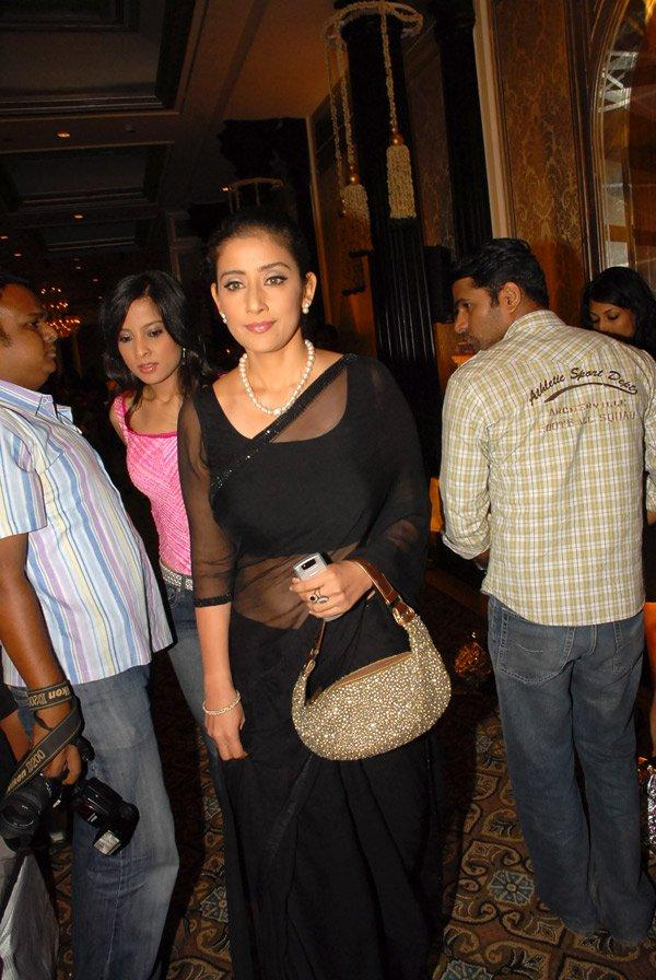 Manisha Koirala Looks Hot In Black Transparent Saree