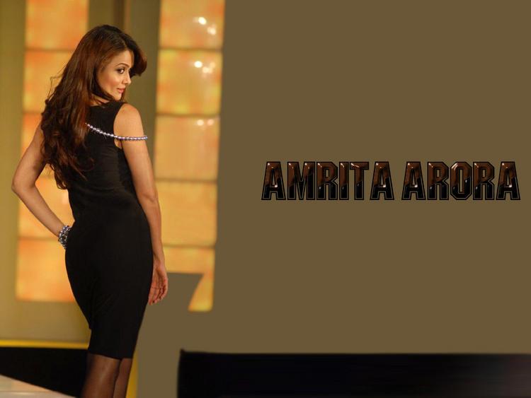 Amrita Arora Sexy Back Exposing Still