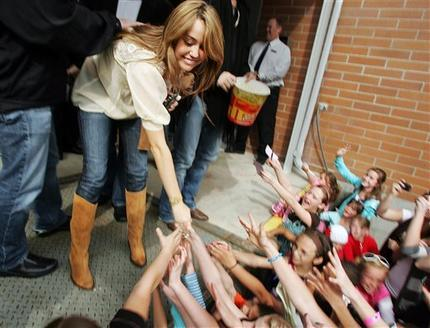 Miley Cyrus and Hannah Montana Public Photo