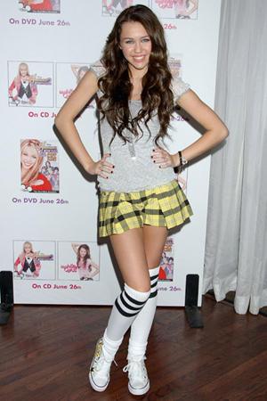 Miley Cyrus Cute Pose In Mini Skirt