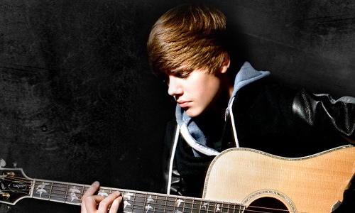 Justin Bieber Guitar Playing Photo