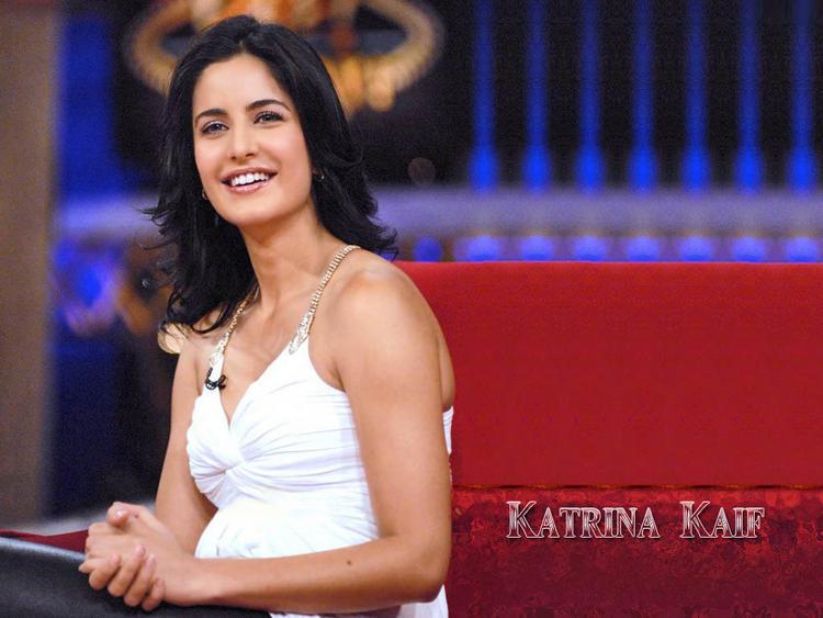Smiling Beauty Katrina Kaif Wallpaper In White Dress