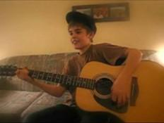 Justin Bieber Guitar Playing Photo