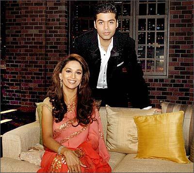 Madhuri Dixit and Karan Poses To Photo Shoot