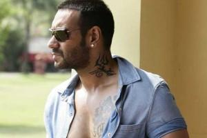 Ajay Devgan Showing Her Tattoo