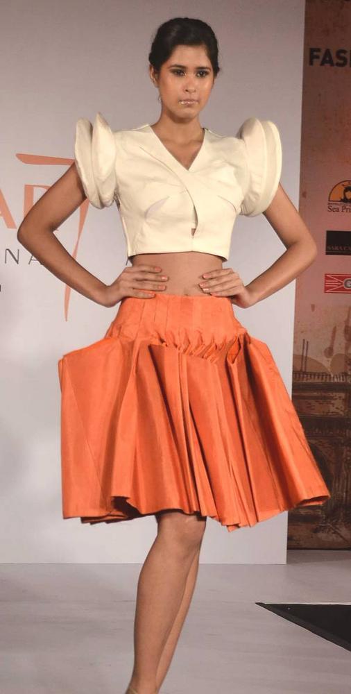 A Model Short Fashionable Looks Walks The Ramp