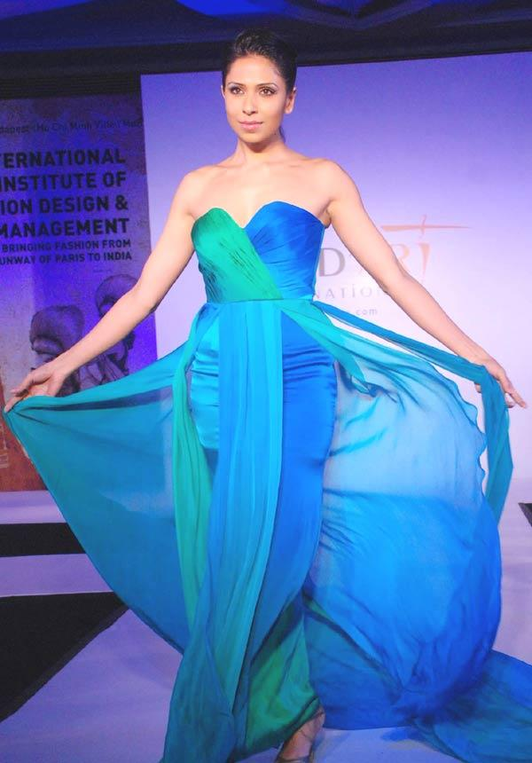 A Model Wearing Glamour Strapless Dress Walks The Ramp