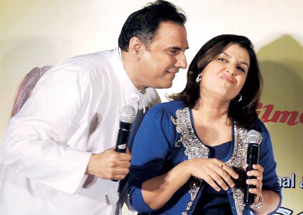 While Boman Irani Tries To Give Farah Khan a Peck She Makes a Face and Looks Away