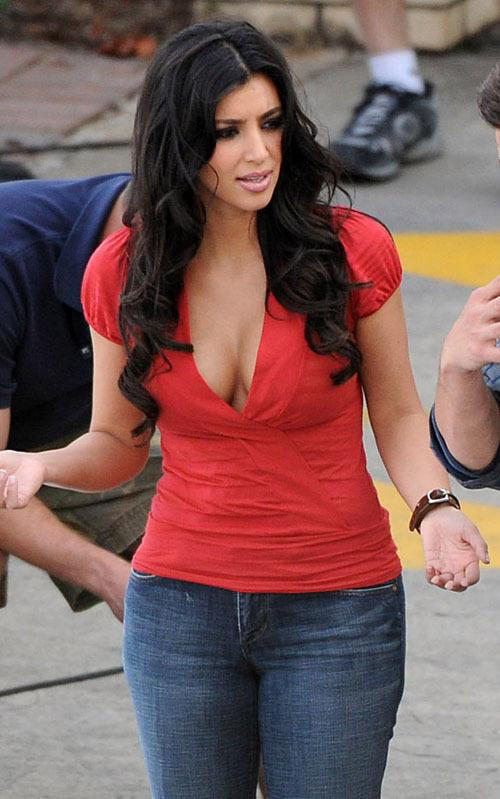 Kim Kardashian Hottest Photo In Red T Shirt and Blue Jeans