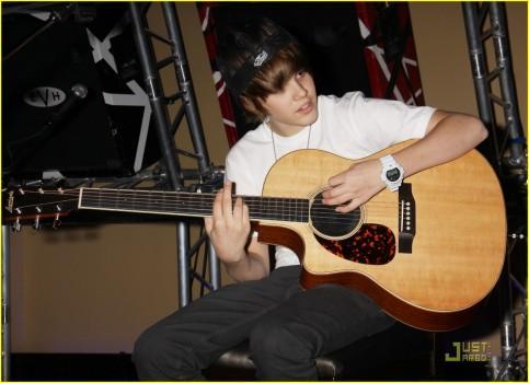 Justin Bieber Guitar Playing Stylist Photo