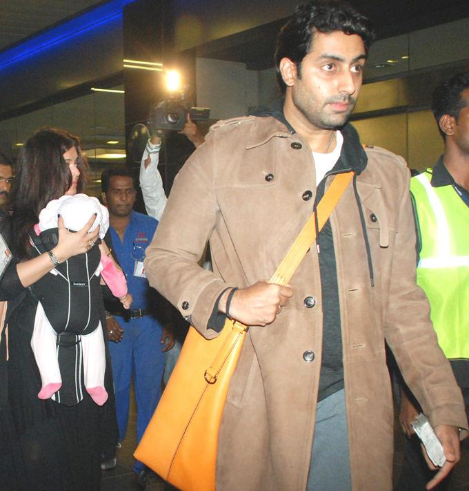 Abhi and Aish Snapped At Mumbai Airport With Baby