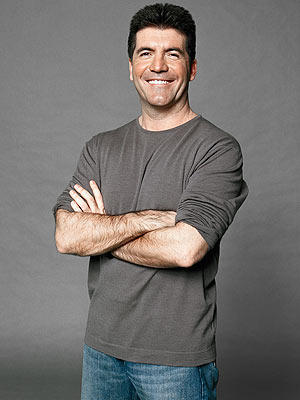 Simon Cowell Smiling With Smart Look Pic