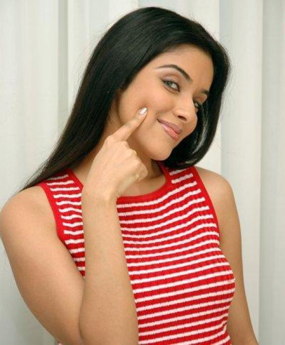 Asin Thottumkal In White and Red Striped Tops