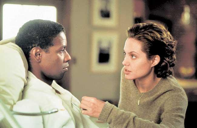 Jolie Played an Unwilling Cop Amelia Donaghy,Haunted by Her Cop Father's Suicide Who Teams Up with Acting Powerhouse Denzel Washington to Catch a Serial Killer on the Prowl