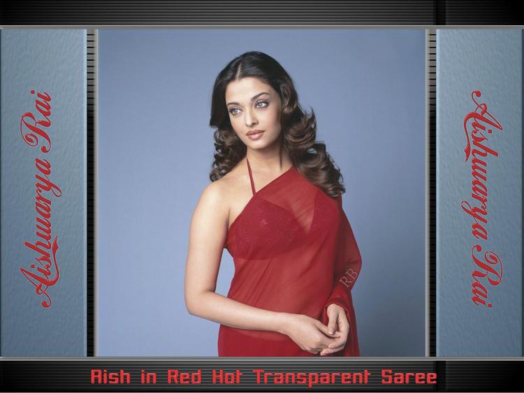 Aishwarya Rai In Red Transparent Saree Sizzling Wallpaper