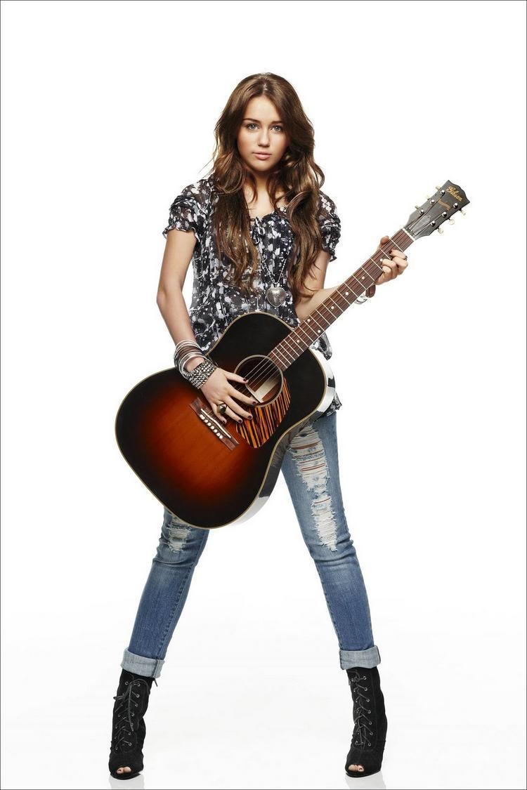 Miley Cyrus Guitar Playing Rocking Pic