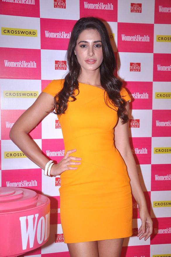 Nargis Fakhri in Wearing Yellow Dress at The Launch Of Women's Health Magazine At Juhu