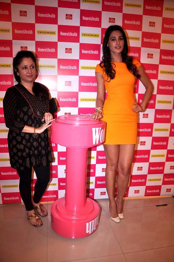 Nargis Fakhri in Wearing Yellow Dress at The Launch Of Women's Health Magazine
