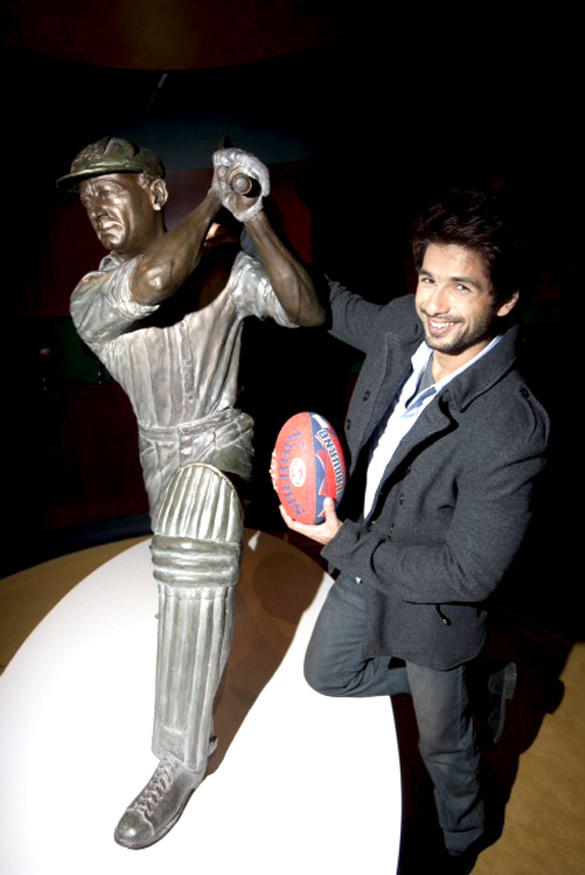 Shahid Posing with the Statue of Don Bradman and Australia Football