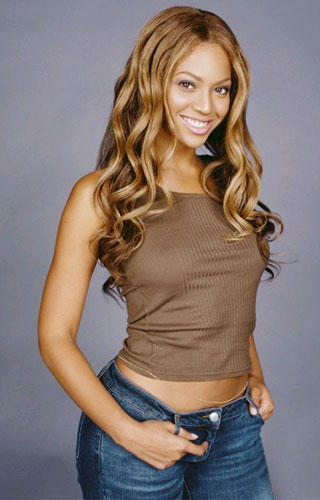 Beyonce Knowles Stylist Pose In Short Tops and Blue Jeans