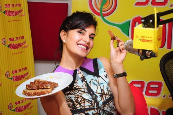 Jacqueline Enjoyed Fruit Cake At Radio Mirchi While Promoting Race 2 Movie