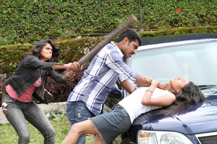 Rithi Mangal And Agatha Fight Scene Photo From Movie Iddara Bhamala Kougililo