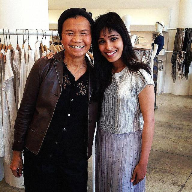 Freida Pinto With A Friend Strikes A Pose At A Designer Store In LA During Shopping