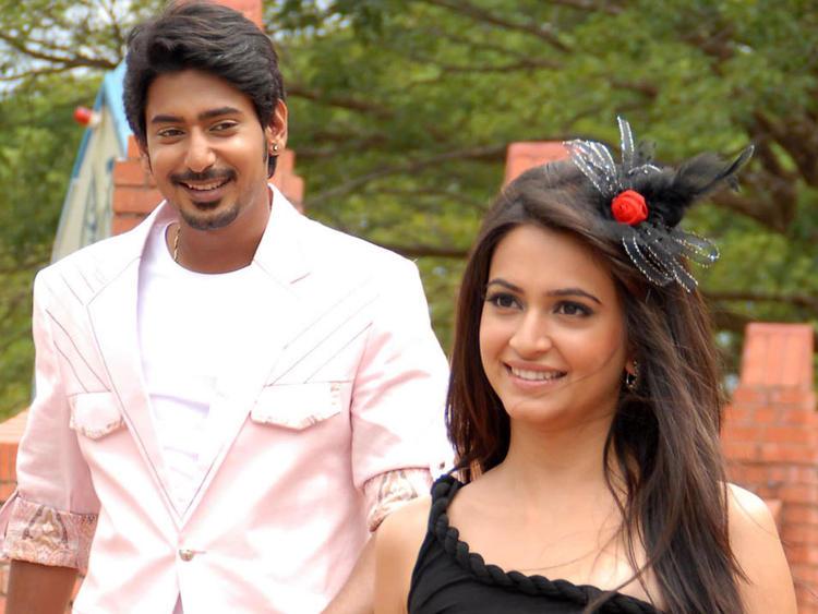 Prajwal And Kriti Cute Smiling Photo Still From Kannada Movie Galate