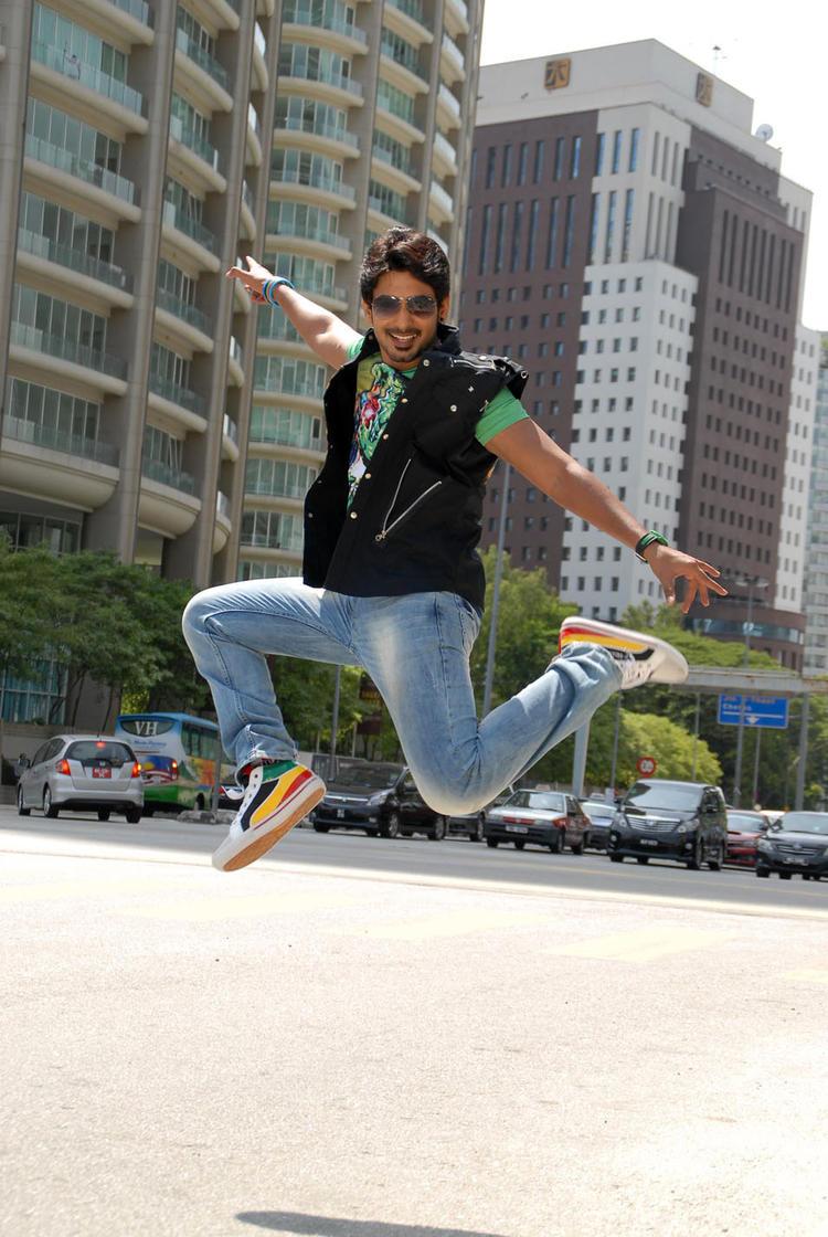 Prajwal Devaraj Jumping Photo Still From Kannada Movie Galate