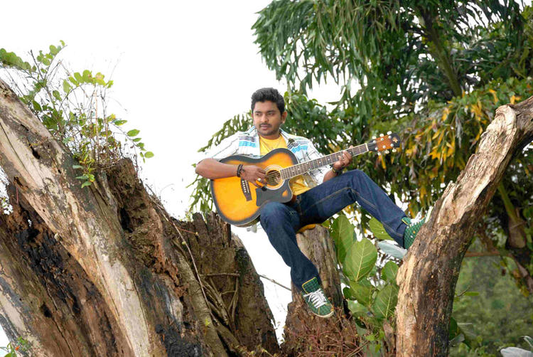 Ajith Patre Playing Guitar Photo From Kannada Movie Ee Bhoomi Aa Bhanu