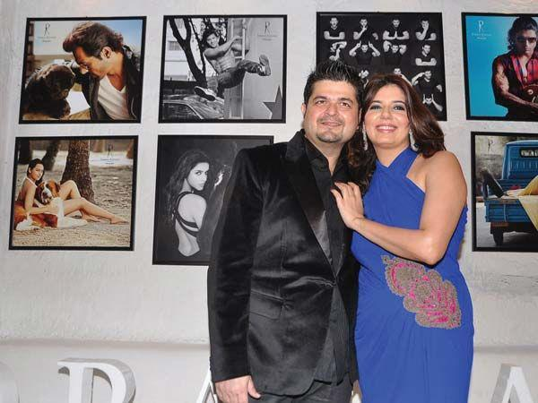 Dabboo With Wife Manisha Posed For Camera At His 2013 Calendar Launch