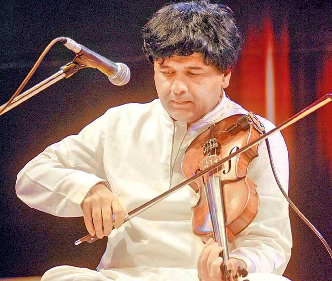 Ganesh Rajagopalan Playing The Guitar In A Musical Concert Event