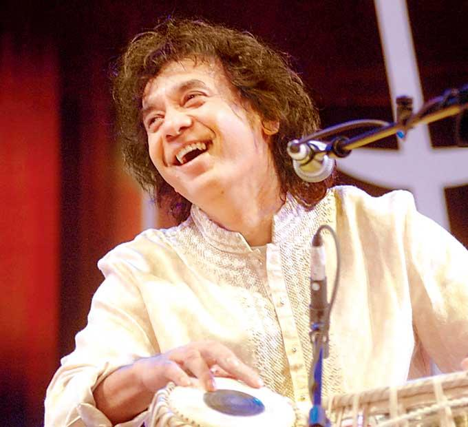 Zakir Hussain Enjoys The Tal Photo Clicked In A Musical Concert Event