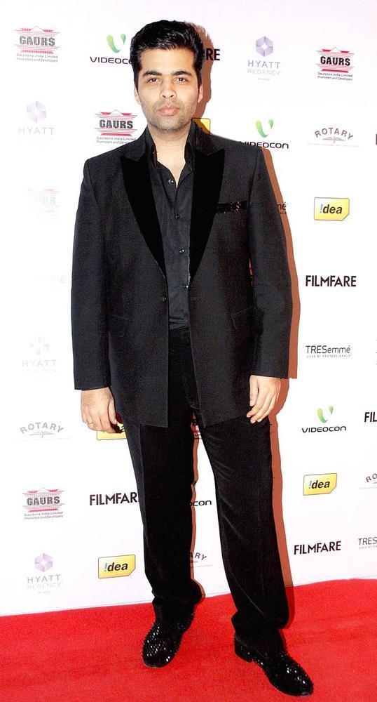 Karan Johar Pose For Camera On Red Carpet At The 57th Filmfare Nomination Party