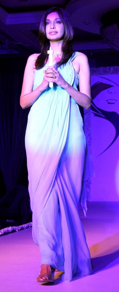 A Model Walks On Ramp With Candle At Beti Fashion Show