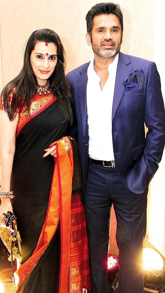 Suneil With Wife Mana Pose For Camera At Sangeet Ceremony Of Gayatri And Arjun Hitkari