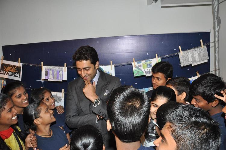 Abhishek And Childrens Chatting Photo Clicked At Art Exhibition Of Radhika Goenka
