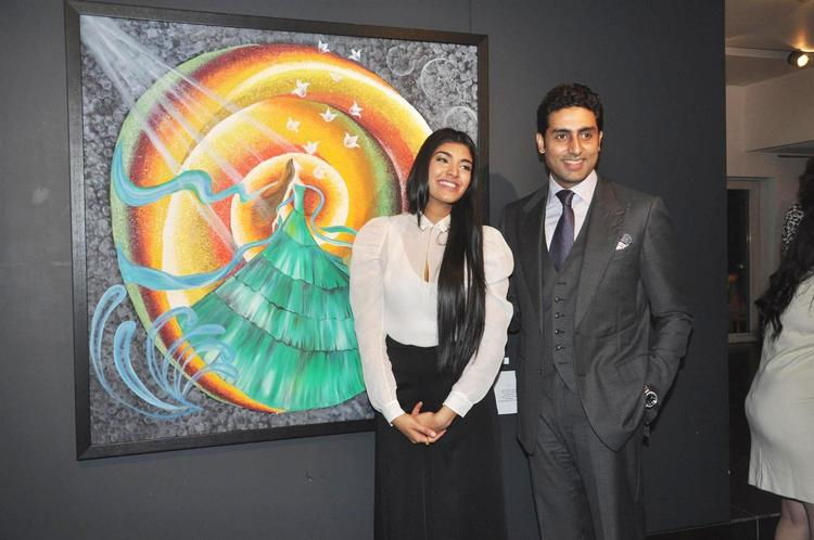 Abhishek And Radhika Pose For Camera At Art Exhibition Of Radhika Goenka